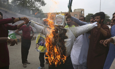 Pakistani protesters burn an effigy of U.S. President Donald Trump in Karachi, Pakistan, Wednesday, Aug. 30, 2017. Protesters objected to Trump's allegation that Islamabad is harboring militants who battle U.S. forces in Afghanistan.