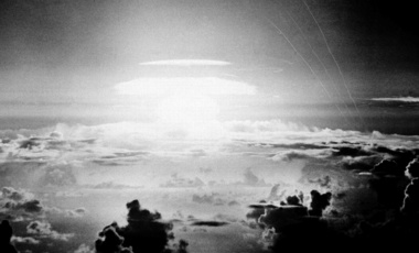 The fireball of a hydrogen bomb lights the Pacific sky a few seconds after the bomb was released over Bikini Atoll on May 21, 1956. (File Photo, AP)