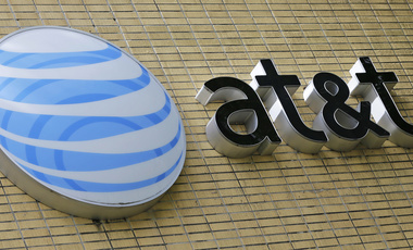 This Oct. 12, 2017, photo shows an AT&T sign at a store in Miami. The Trump administration is opposing the proposed AT&T-Time Warner merger (AP Photo/Alan Diaz).