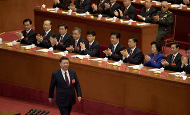 Chinese President Xi Jinping is applauded as he walks to the podium to deliver his speech at the opening ceremony of the 19th Party Congress, held at the Great Hall of the People in Beijing on Oct. 18, 2017. (AP Photo/Ng Han Guan)