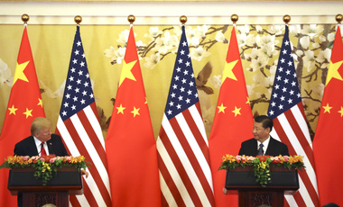 U.S. President Donald Trump and Chinese President Xi Jinping, right, look at each other during a joint press conference at the Great Hall of the People in Beijing. November 9, 2017 (Andrew Harnik/Associated Press).