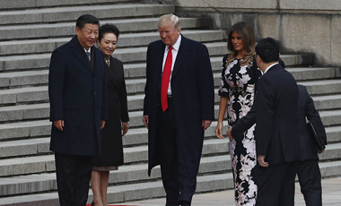 From left, Chinese President Xi Jinping, Chinese first lady Peng Liyuan, U.S. President Donald Trump and U.S. first lady Melania Trump are shown at the Great Hall of the people in Beijing on Thursday, November 9, 2017. (AP Photo/Andy Wong)