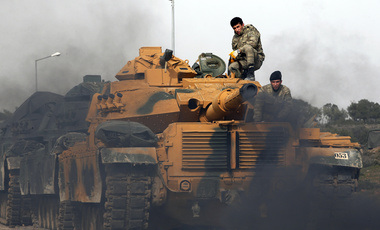 Turkish armor prepares for combat at a staging area in Sugedigi, Turkey, on the border with Syria, Monday, Jan. 22, 2018. (AP Photo/Lefteris Pitarakis)