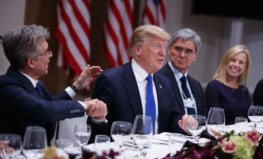 President Donald Trump listens during a dinner with European business leaders at the World Economic Forum, Thursday, Jan. 25, 2018, in Davos. From left, SAP CEO Bill McDermott, Trump, CEO of Seimens Joe Kaeser, and Secretary of Homeland Security Kirstjen Nielsen. (AP Photo/Evan Vucci)