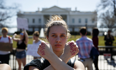 Gwendolyn Frantz, 17, of Kensington, Md., stands in front of the White House during a student protest for gun control on Wednesday, Feb. 21, 2018, in Washington. (AP Photo/Evan Vucci)