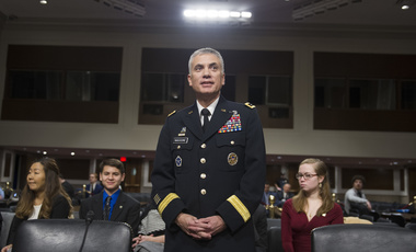 Army Lieutenant General Paul Nakasone waits at the witness table in the U.S. Senate