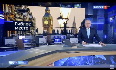 "In this video grab provided by RU-RTR Russian television on March 11, 2018, Dimtry Kiselev, one of Russia's most powerful media figures, speaks during his Sunday news program on state-owned TV channel Rossiya-1, in Moscow, Russia. His segment about former Russian Double agent Sergei Skripal and his daughter who were poisoned in Britain a week ago, was in sync with a reflexive response of Russian officials to attribute nearly all criticism from the West to anti-Russia bias. The words at top left read ""death"