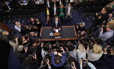 Facebook CEO Mark Zuckerberg arrives to testify before a joint hearing of the Commerce and Judiciary Committees on Capitol Hill in Washington, Tuesday, April 10, 2018