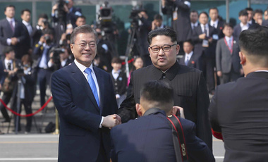 North Korean leader Kim Jong Un, right, poses with South Korean President Moon Jae-in for a photo at the border village of Panmunjom in the Demilitarized Zone. April 27, 2018 (Korea Summit Press Pool via AP).