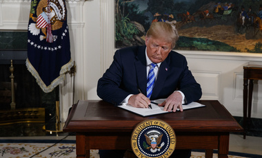 President Donald Trump signs a Presidential Memorandum on the Iran nuclear deal from the Diplomatic Reception Room of the White House, Tuesday, May 8, 2018, in Washington. Trump announced the U.S. will pull out of the landmark nuclear accord with Iran, dealing a profound blow to U.S. allies and potentially deepening the president's isolation on the world stage.