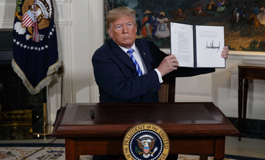 President Donald Trump signs a Presidential Memorandum on the Iran nuclear deal from the Diplomatic Reception Room of the White House on Tuesday, May 8, 2018, in Washington. (AP Photo/Evan Vucci)