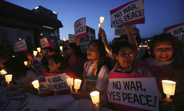 Protesters stage a rally for peace on the Korea peninsular near U.S. Embassy in Seoul on Wednesday, May 23, 2018. (AP Photo/Ahn Young-joon)