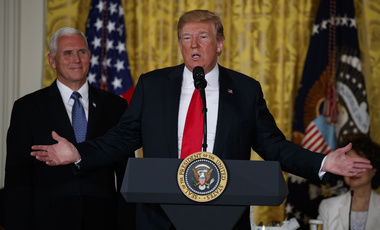 Vice President Mike Pence listens as President Donald Trump speaks during a meeting of the National Space Council in the East Room of the White House, June 18, 2018, in Washington. (AP Photo/Evan Vucci)
