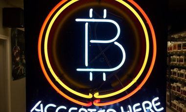 In this photo from Feb. 7th, 2018, a neon bitcoin sign hangs in the window of a local business.