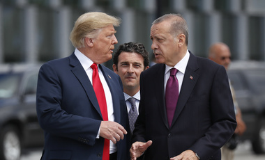President Donald Trump talks with Turkey's President Recep Tayyip Erdogan, at a summit of heads of state and government at NATO headquarters in Brussels on Wednesday, July 11, 2018. (AP Photo/Pablo Martinez Monsivais)