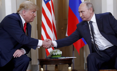 U.S. President Donald Trump, left, and Russian President Vladimir Putin shake hand at the beginning of a meeting at the Presidential Palace in Helsinki, Finland on Monday, July 16, 2018. (AP Photo/Pablo Martinez Monsivais)