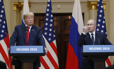 U.S. President Donald Trump, left, listens to Russian President Vladimir Putin during a press conference after their meeting at the Presidential Palace in Helsinki, Finland on Monday, July 16, 2018. (AP Photo/Alexander Zemlianichenko)