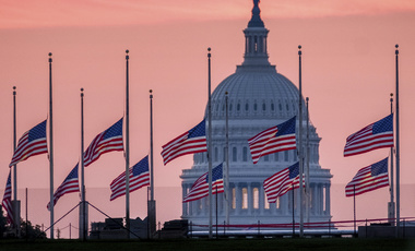 Flags flying a half-staff in honor of Sen. John McCain, R-Ariz., frame the U.S. Capital at daybreak in Washington, Sunday on August 26, 2018.