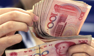 In this photo taken on August 25, 2010, a bank clerk counts Chinese 100 Yuan notes in Shanghai.