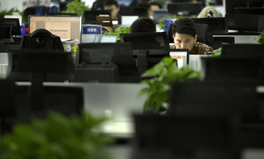 A Watrix employee works at his desk in their company's offices in Beijing, October 31, 2018. Watrix, a Chinese technology startup hopes to begin selling software that recognizes people by their body shape and how they walk, enabling identification when faces are hidden from cameras.