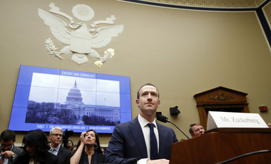 Photo of Mark Zuckerberg preparing to resume testimony about user data on Facebook.