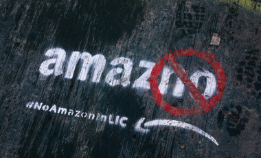 "Graffiti painted on the sidewalk that reads ""amazno"" by someone opposed to the location of the Amazon headquarters in New York"