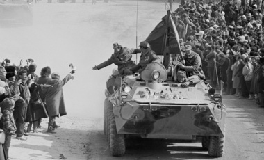 Photo taken on Feb. 15, 1989, people and relatives greet Soviet Army soldiers driving on their armored personnel carriers after crossing a bridge on the border between Afghanistan and then Soviet Uzbekistan near the Uzbek town of Termez, Uzbekistan.