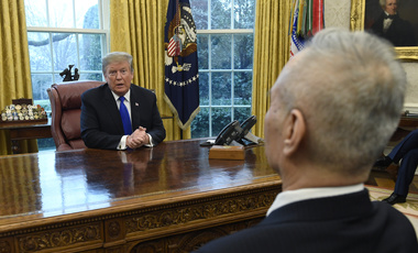 U.S. President Donald Trump speaks with Chinese Vice Premier Liu He about trade relations between their two countries, February 22, 2019.