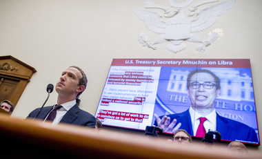 Comments from Treasury Secretary Steven Mnuchin on Facebooks Libra proposal are displayed on a monitor behind Facebook CEO Mark Zuckerberg as he testifies before a House Financial Services Committee hearing on Capitol Hill in Washington, Wednesday, Oct. 23, 2019, on Facebook's impact on the financial services and housing sectors.