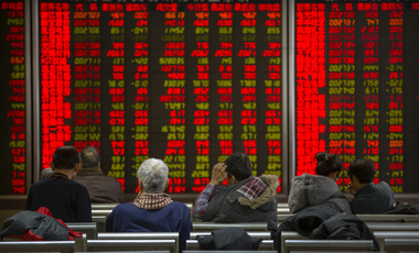 Chinese investors monitor stock prices at a brokerage house in Bejiing, Thursday, Dec. 26, 2019. Shares are mostly higher in Asia with many world markets closed for Christmas holidays.