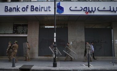 Lebanese soldiers secure a bank, after the anti-government protesters try to destroy banks windows during a protest against the Lebanese central bank's governor Riad Salameh and against the deepening financial crisis, at Hamra trade street, in Beirut, Lebanon.