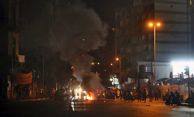 Anti-government demonstrators burn tires to block a road in Beirut on Tuesday.