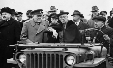 In this photo provided by the Department of Defense, President Franklin D. Roosevelt sits in a jeep at Yalta with British Prime Minister Winston Churchill and V.M. Molotov, Feb. 1945.