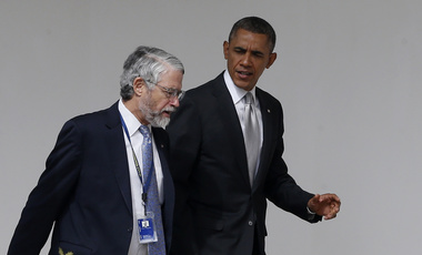 John P. Holdren walking with President Barak Obama on Friday, March 7, 2014. At the time, Holdren was serving as Assistant to the President for Science and Technology and Director of the White House Office of Science and Technology Policy. (AP Photo/Charles Dharapak)