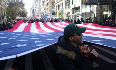 Parade participants unfurl a huge American Flag during the 2017 Veterans Day Parade held along 5th Avenue in New York City on Nov. 11, 2017 (Photo by mpi43/MediaPunch/IPX).
