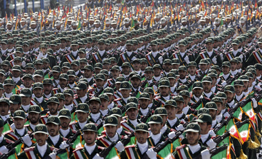 Iran's Revolutionary Guard troops march in a military parade in Tehran during the 2012 commemoration of the country's war with Iraq, September 12, 2012.