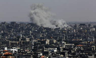 Smoke and dust rise after an Israeli strike hits in Gaza City. August 26, 2014 (Adel Hana/Associated Press). Keywords: Gaza City, Gaza Strip, airstrike, Israel