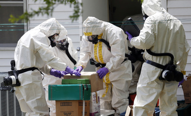 On April 19, 2013, federal agents wearing hazardous material suits and breathing apparatus inspect the home and possessions of a Mississippi man who was later convicted for mailing ricin to President Obama (AP Photo/Rogelio V. Solis)