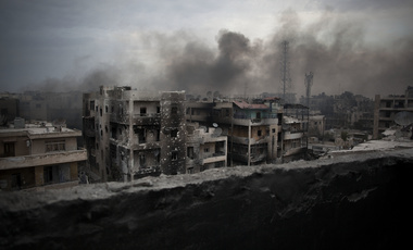 "In this Tuesday, Oct. 2, 2012 file photo, smoke rises over Saif Al Dawla district in Aleppo, Syria. It began in March 2011 with a few words spray-painted on a schoolyard wall: ""Your turn is coming, doctor."" The doctor in question was Syrian President Bashar Assad, a trained ophthalmologist whose family has ruled the country for more than 40 years. (AP Photo/ Manu Brabo, File)"