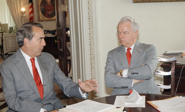 Sen. Bob Dole, left, and Sen. Robert Byrd in Byrd's Capitol Hill office in August 1988. President Trump and current members of Congress could use the Senate Arms Control Observer Group they established as a model for cooperation between the branches, particularly when dealing with dangerous issues like U.S.-Russia relations, Sam Nunn and Ernest J. Moniz write (AP Photo/Scott Stewart)
