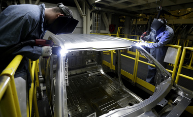 In this March 13, 2015 photo, workers weld body panels on the new aluminum-alloy body Ford F-150 truck at the company's Kansas City Assembly Plant in Claycomo, Mo (AP Photo/Charlie Riedel).