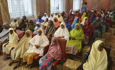 Nigerian schoolgirls sitting in presidential palace