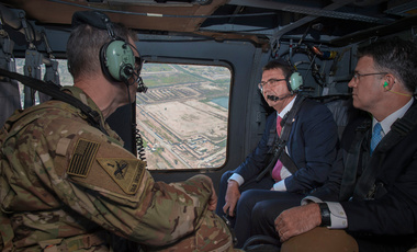Secretary of Defense Ash Carter speaks with Army Lt. Gen. Sean MacFarland, Commander Combined Joint Task Force- Operation Inherent Resolve as they fly to the Green Zone in Baghdad, Iraq in a UH-60 helicopter to meet with Iraqi leaders to discuss matters of usual importance Apr. 18, 2016.