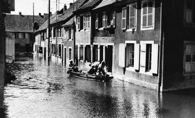 French soldiers paddling from house to house in an inundated western front village searching for food in France on June 7, 1940. The French voluntarily flooded the village in an attempt to hold up the blitzkrieging German army.
