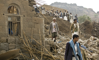 Yemenis stand amid the rubble of houses destroyed by Saudi-led airstrikes in a village near Sanaa, Yemen.