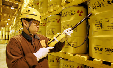 A worker checks the radioactivity of drums containing nuclear waste at Yonggwang Nuclear Power Site in Yonggwang, South Korea.