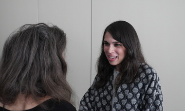 Photo of Aditi Kumar greeting Belfer Center staff