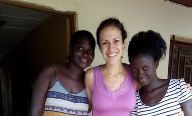 Zoe Marks (center) with her translator Patricia Turay and her family in Makeni, Sierra Leone, where Marks was researching impacts of civil war and its aftermath.