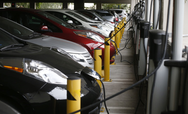 Electric cars sit charging in a parking garage at the University of California, Irvine, January 26, 2015.