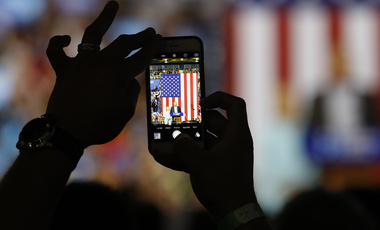 An attendee shoots a photo on a cell phone of Democratic U.S vice presidential candidate Senator Tim Kaine speaking as he appears with Democratic U.S. presidential candidate Hillary Clinton during a campaign rally in Miami, Florida, U.S. July 23, 2016.